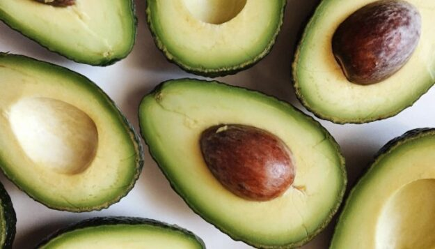 try-this-genius-hack-for-removing-an-avocado-pit-(without-a-knife)